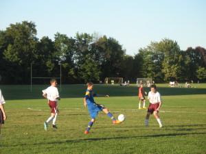 JV - Owen volleys the ball over an Eden defender